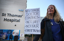 © Licensed to London News Pictures. 12/01/2016. London, UK. A junior doctor stands on a picket line outside St Thomas' Hospital.  Doctors are holding a one day strike over proposed new working hours - the first strike in 40 years. Photo credit: Peter Macdiarmid/LNP