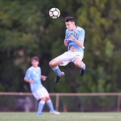BRISBANE, AUSTRALIA - JANUARY 27: Scott Halliday of City heads the ball during the Kappa Silver Boot Third Place match between Moreton Bay United and Brisbane City on January 27, 2018 in Brisbane, Australia. (Photo by Patrick Kearney)