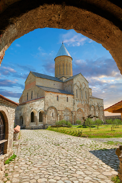 Pictures & images of the the medieval Alaverdi St George Cathedral & monastery complex from the gate house, 11th century, near Telavi, Georgia (country). <br /> <br /> At 50 meters high Alaverdi St George Cathedral was once the highest cathedral in Georgia (now its the nes Tblisi cathedral). The cathedral is part of a Georgian Orthodox monastery founded by the monk Joseph [Abba] Alaverdeli, who came from Antioch and settled in Alaverdi. On the UNESCO World Heritage Site Tentative List. .<br /> <br /> Visit our MEDIEVAL PHOTO COLLECTIONS for more   photos  to download or buy as prints https://funkystock.photoshelter.com/gallery-collection/Medieval-Middle-Ages-Historic-Places-Arcaeological-Sites-Pictures-Images-of/C0000B5ZA54_WD0s .<br /> <br /> Visit our REPUBLIC of GEORGIA HISTORIC PLACES PHOTO COLLECTIONS for more photos to browse, download or buy as wall art prints https://funkystock.photoshelter.com/gallery-collection/Pictures-Images-of-Georgia-Country-Historic-Landmark-Places-Museum-Antiquities/C0000c1oD9eVkh9c