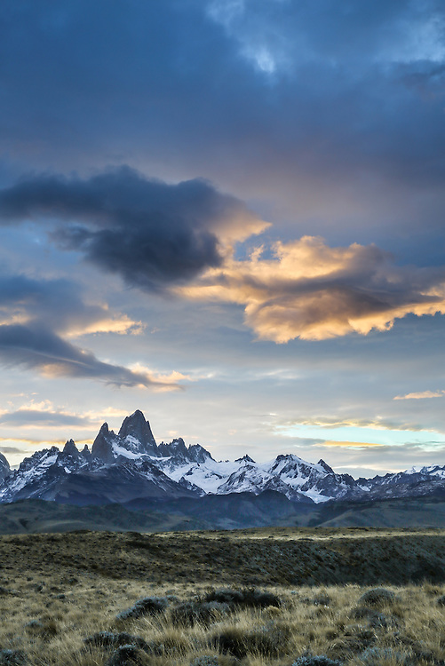 A golden glow lingers on the clouds above Fitz Roy.  Los Glaciares National Park, Argentina.