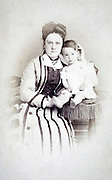 portrait young adult mother with little child late 1800s