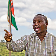 WIth the Kenyan flag flying high behind him, Wareng Youth Initiative for Peace and Development (WYIPD) Programme Manager Fred Yego appeals to a gathering of youth leaders that it is for young people to make their own decisions, and that they should not wait for outsiders to make their decisions for them. Village of Soba, located in Nandi County in Kenya's Rift Valley Province.