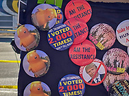 Anti-Trump buttons being sold. in Washington D.C. during Biden's inuguaration.