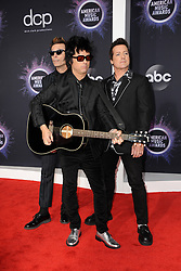 Mike Dirnt, Billie Joe Armstrong and Tré Cool of Green Day at the 2019 American Music Awards held at the Microsoft Theater in Los Angeles, USA on November 24, 2019.
