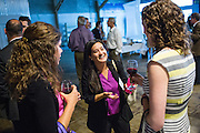 Pamela Crouch of ProspectSV (center) talks with other guests during the Silicon Valley Business Journal's HHaaS Tech Mixer at ZERO1 in San Jose, California, on May 28, 2015. (Stan Olszewski/SOSKIphoto for the Silicon Valley Business Journal)