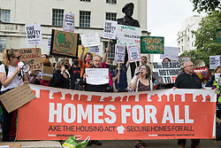 Tanya Murat of Southwark Defend Council Housing addresses a protest opposite Downing Street organised by leaseholders and tenants living in unsafe homes on 15th July 2021 in London, United Kingdom. The protesters, some of whom are faced with crippling costs to fix safety issues, called on the government to ensure that their homes are made safe from fire as a matter of priority, to make interim payments and to cover fire safety remediation costs and to find a solution with mortgage lenders which enables them to move on with their lives. Many of the speakers also called for justice for the survivors and victims of the Grenfell fire.