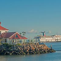 A Carnival cruise ship anchors behind a restaurant at Long Beach Harbor, California.