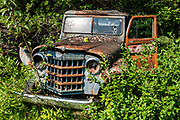 Old rusting truck at Fort Nelson Heritage Museum, 5553 Alaska Highway, Fort Nelson, British Columbia, Canada. This quirky museum features a highway construction display, pioneer artifacts, trapper's cabin, vintage autos & machinery, a white moose, and more.