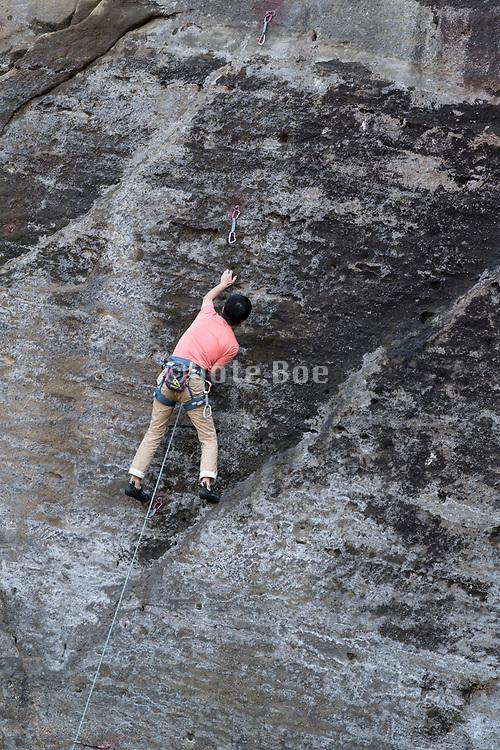 climbing of a vertical rock mountain wall in Takatoriyama park Kanagawa Japan
