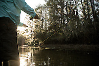 ANGLER STRIPPING LINE THROUGH THE WATER