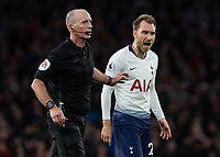 Football - 2018 / 2019 Premier League - Arsenal vs. Tottenham Hotspur<br /> <br /> Christian Eriksen (Tottenham FC)  makes his feelings known to Referee Mike Dean at The Emirates.<br /> <br /> COLORSPORT/DANIEL BEARHAM