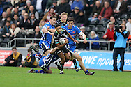 Keelan Giles of the Ospreys © makes a strong run but is tackled by Tavis Knoyle of Newport Gwent Dragons .Guinness Pro12 rugby match, Ospreys v Newport Gwent Dragons at the Liberty Stadium in Swansea, South Wales on 29th October 2016.<br /> pic by Andrew Orchard, Andrew Orchard sports photography.