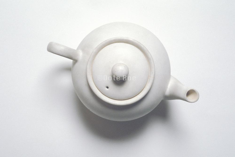 overhead view of white teapot