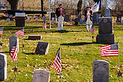 11 NOVEMBER 2020 - DES MOINES, IOWA: ALAN WENGER, left, and MIKE ROWLEY, members of Sons of the Revolution, during the Veterans' Day service in Woodland Cemetery in Des Moines. Volunteers read the names of the approximately 1,000 veterans buried in the cemetery. The observance at Woodland Cemetery was one of the few live Veterans Day ceremonies in the Des Moines area this year. Most were held online only because of the Coronavirus pandemic.  PHOTO BY JACK KURTZ