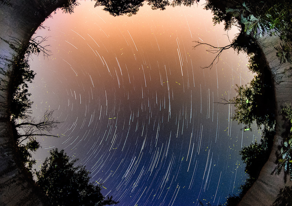 """Detonation of the explosives stored within this underground bunker, termed """"igloo"""" for its dome-like shape, destroyed the top leaving this lovely view of the sky, stars and fireflies.  Shot in the """"TNT area"""" of Point Pleasant, West Virginia."""