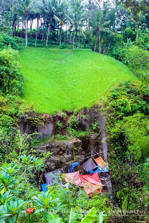Bali, Gianyar, Bedulu. Mining of sandstone; a mine beneath a rice field.
