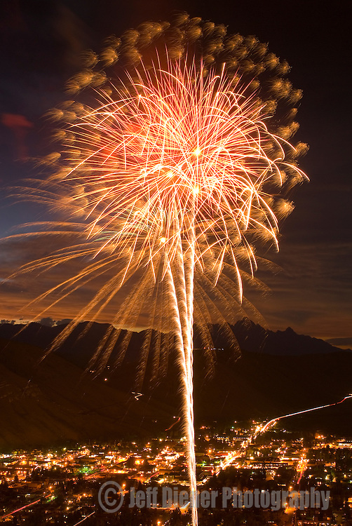 Fourth of July fireworks fly over the town of Jackson in Jackson Hole, WY.