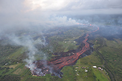 Handout photo taken on May 19, 2018 of KÄ«lauea Volcano — Channelized Lava Flow. Channelized lava emerges from the elongated fissure 16-20 (in the upper right). Photo taken May 19, 2018, at 8:18 AM HST. Photo by usgs via ABACAPRESS.COM