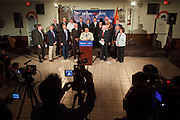 15 FEBRUARY 2010 -- TEMPE, AZ: Michael Hing (CENTER AT PODIUM) Mayor of Superior, AZ, talks about Sen John McCain (R-AZ) to Hing's left, during a press conference at American Legion Hall Post 2 in Tempe Monday morning. McCain introduced more than 30 mayors from across Arizona that have or will be endorsing him in his primary against former TV sports anchor and Congressman J.D. Hayworth. Hayworth, an arch conservative, is running against McCain for being too liberal on spending and immigration.   PHOTO BY JACK KURTZ