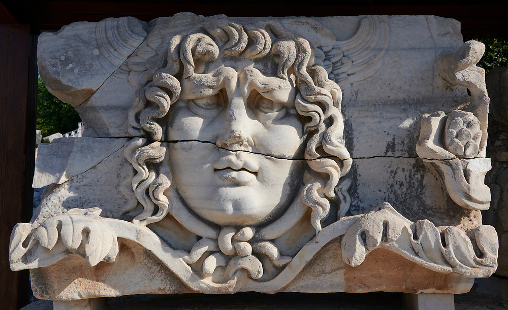Picture of the ruins of a Medusa relief frieze from the Ancient Ionian Greek  Didyma Temple of Apollo & home to the Oracle of Apollo.  Also known as the Didymaion completed circa 550 BC. modern Didim in Aydin Province, Turkey. .<br /> <br /> If you prefer to buy from our ALAMY PHOTO LIBRARY  Collection visit : https://www.alamy.com/portfolio/paul-williams-funkystock/didyma-temple-turkey.html<br /> <br /> Visit our TURKEY PHOTO COLLECTIONS for more photos to download or buy as wall art prints https://funkystock.photoshelter.com/gallery-collection/3f-Pictures-of-Turkey-Turkey-Photos-Images-Fotos/C0000U.hJWkZxAbg