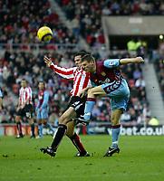 Photo: Andrew Unwin.<br />Sunderland v Aston Villa. The Barclays Premiership.<br />19/11/2005.<br />Sunderland's Tommy Miller (L) closes in on Aston Villa's James Milner (R).