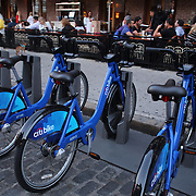 A Citi Bike docking station in a restaurant area of Chelsea,  Manhattan, New York. Citi Bike the NYC Bicycle Share Program sponsored by Citi Bank, launched in late May 2013 giving access to thousands of bikes at docking stations throughout  Manhattan and parts of Brooklyn. Manhattan, New York, USA. 4th June 2013. Photo Tim Clayton
