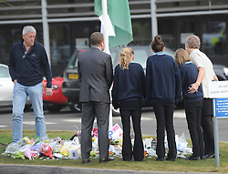 © Licensed to London News Pictures. 20/02/2012. Alvechurch, UK. School children and teachers comfort each other as they arrive back to Alvechurch Middle School following the coach crash which claimed a life of one of their teachers, 52 year old Peter Rippington.  The accident, which happened following a skiing trip in France has also left 10 other children injured with one remaining critically ill.    Photo credit: Alison Baskerville/LNP