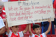 Arsenal fans show their appreciation of Arsenal manager Arsene Wenger during the Premier League match between Arsenal and West Ham United at the Emirates Stadium, London, England on 22 April 2018. Picture by Bennett Dean.