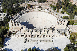 © Licensed to London News Pictures. 19/03/2020 . Athens , Greece . An Aerial view of Odeon of Herodes Atticus  is seen empty  due to coronavirus outbreak in Athens .  Greece has promised sweeping financial support for businesses shuttered by the coronavirus crisis as store closures were extended Wednesday to most of the country's retail sector.  Photo credit: Ioannis Alexopoulos /LNP