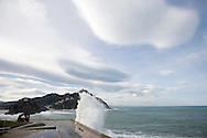 """The waves hit a retaining wall next to """"Empty Building"""" sculpture of the Basque sculptor Jorge Oteiza in the """"New Ride"""" of Donostia on February 9, 2014, Basque Country. (Ander Gillenea / Bostok Photo)"""