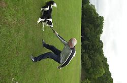 Eddie Sander with his Dogs Jackson and Inka<br /><br />18 June 2004<br /><br />Copyright Paul David Drabble<br /> [#Beginning of Shooting Data Section]<br />Nikon D1 <br /> Focal Length: 22mm<br /> Optimize Image: <br /> Color Mode: <br /> Noise Reduction: <br /> 2004/06/18 09:33:40.6<br /> Exposure Mode: Manual<br /> White Balance: Auto<br /> Tone Comp: Normal<br /> JPEG (8-bit) Fine<br /> Metering Mode: Center-Weighted<br /> AF Mode: AF-S<br /> Hue Adjustment: <br /> Image Size:  2000 x 1312<br /> 1/200 sec - F/8<br /> Flash Sync Mode: Not Attached<br /> Saturation: <br /> Color<br /> Exposure Comp.: 0 EV<br /> Sharpening: Normal<br /> Lens: 17-35mm F/2.8-4<br /> Sensitivity: ISO 200<br /> Image Comment: <br /> [#End of Shooting Data Section]