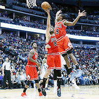 22 November 2016: Chicago Bulls guard Rajon Rondo (9) grabs a rebound over Denver Nuggets center Jusuf Nurkic (23) and Chicago Bulls center Robin Lopez (8) during the Denver Nuggets 110-107 victory over the Chicago Bulls, at the Pepsi Center, Denver, Colorado, USA.