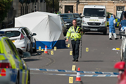 © Licensed to London News Pictures. 29/08/2015. Bristol UK. Police investigate after a man's body is found in Gordon Road, Clifton, in a suspected hit and run. Photo credit : Simon Chapman/LNP