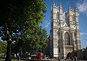 The tall western facade of London's Westminster Abbey with a new generation red London Routemaster double-decker bus passing-by. Since 1066, when Harold Godwinson and William the Conqueror were crowned, the coronations of English and British monarchs have been held here. Since 1100, there have been at least 16 royal weddings at the abbey. Two were of reigning monarchs (Henry I and Richard II), although before 1919 there had been none for some 500 years