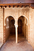 Moorish arches and decoration in the Mosque Baths of the Alhambra complex, Granada, Spain