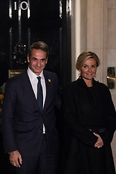London, UK. 3 December, 2019. Kyriakos Mitsotakis, Prime Minister of Greece, arrives with his wife Mareva Grabowski-Mitsotakis for a reception for NATO leaders at 10 Downing Street on the eve of the military alliance's 70th anniversary summit at a luxury hotel near Watford.