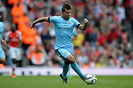 Manchester City's Sergio Aguero running in action.  Barclays Premier league match, Arsenal v Manchester city at the Emirates Stadium in London on Saturday 13th Sept 2014.<br /> pic by John Patrick Fletcher, Andrew Orchard sports photography.