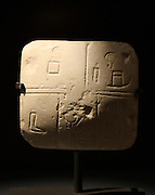Early writing and accounts in Mesopotamia.  Modern cast of stone tablet with protocuneiform script.  Around 3200 BC, Kish, Iraq