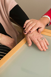 Hands of two senior woman comfort each other, Munich, Bavaria, Germany