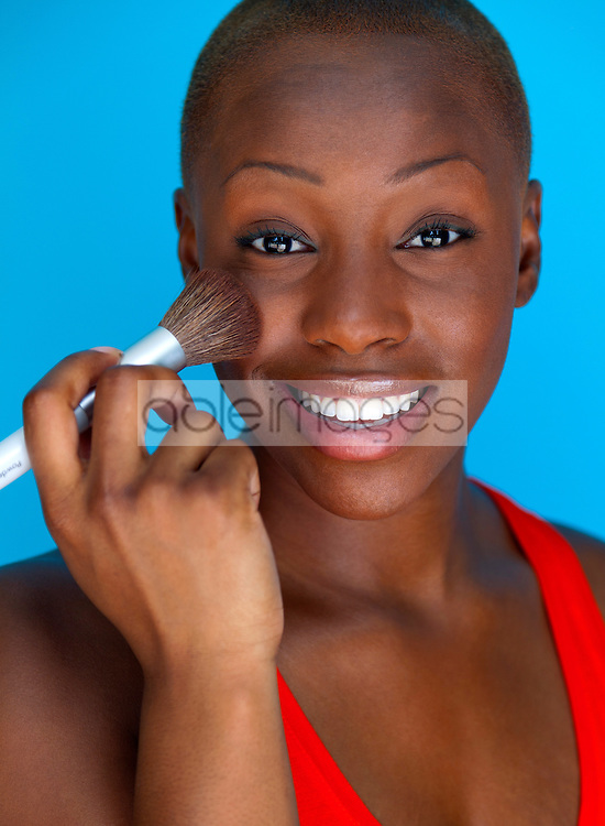Young Woman Applying Blush