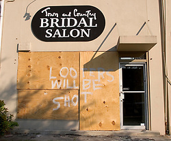 21 Sept 2005. New Orleans, Louisiana.  Hurricane Katrina aftermath.<br /> Looters will be shot sign in a shop window on St Charles Ave in New Orleans. 'Looters will be shot.'<br /> Photo; ©Charlie Varley/varleypix.com