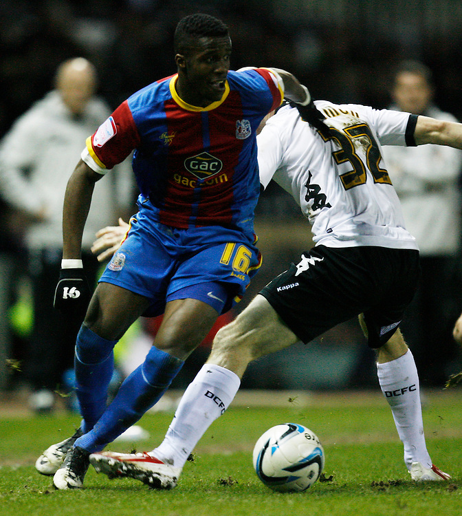 Crystal Palace's Wilfried Zaha (L) in action   ...Football - npower Football League Championship - Derby County v Crystal Palace - Friday 01st March 2013 - Pride Park - Derby..© CameraSport - 43 Linden Ave. Countesthorpe. Leicester. England. LE8 5PG - Tel: +44 (0) 116 277 4147 - admin@camerasport.com - www.camerasport.com
