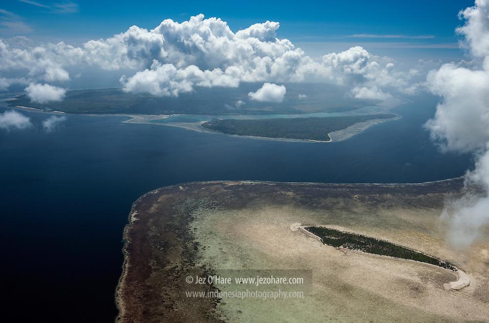 Sawa (or Sawah/Sava) island (RHS) on Lentea island reef, Wakatbobi Dive Resort on Tolandona island (middle) & Tomia island (top), Wakatobi National Park, Tukang Besi Islands, South East Sulawesi, Indonesia