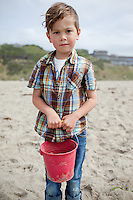 Oliver Whitehead visits the beach at Lincoln City, Oregon with his red bucket