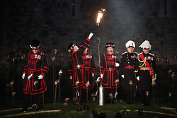 © Licensed to London News Pictures. 04/11/2018. London, UK.Opening ceremony as thousands of flames illuminate the moat of The Tower of London in an installation entitled 'Beyond the Deepening Shadow: The Tower Remembers'. This public act of remembrance for the lives of the fallen, honouring their sacrifice will run for eight nights, leading up to and including the Centenary Armistice Day 2018. The evolving installation will unfold each evening over the course of four hours, with the Tower moat gradually illuminated by individual flames. A specially-commissioned sound installation 'a sonic exploration of the shifting tide of political alliances, friendship, love and loss in war' will be played. At the centre of the sound installation lies a new choral work, with words from war poet Mary Borden's Sonnets to a Soldier. Photo credit: Peter Macdiarmid/LNP