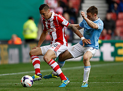 Stoke City's Geoff Cameron and Manchester City's James Milner battle for the ball - Photo mandatory by-line: Matt Bunn/JMP - Tel: Mobile: 07966 386802 14/09/2013 - SPORT - FOOTBALL -  Britannia Stadium - Stoke-On-Trent - Stoke City V Manchester City - Barclays Premier League