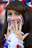 A female fan of France with painted nails