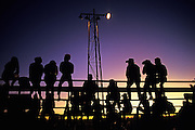 Image of spectators at the Santa Fe Rodeo at night, Santa Fe, New Mexico, American Southwest by Randy Wells