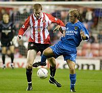 Photo. Glyn Thomas.<br /> Sunderland v Cardiff. Nationwide Division 1.<br /> Stadium of Light, Sunderland. 14/10/03.<br /> Sunderland's Colin Healy (L) and John Robinson battle for possession.