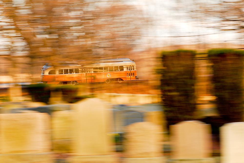 The Ashmont-Mattapan High Speed Trolly weaves through the Cedar Grove Cemetery in Dorchester, MA.